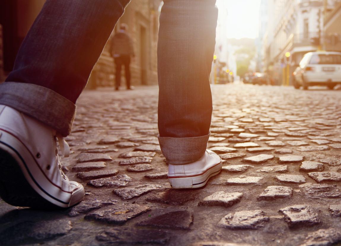 prosthetic foot walking on a street